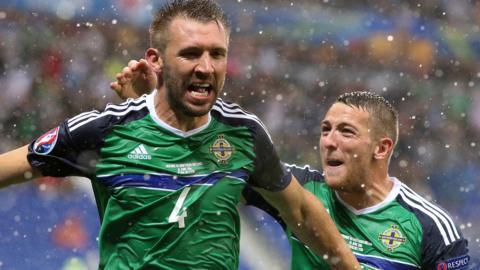 Gareth McAuley celebrates scoring against Northern Ireland