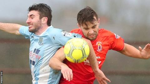 Ballymena United's Joe McKinney and Dungannon's Chris Hegarty
