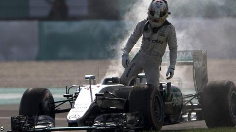 Lewis Hamilton steps out of his Mercedes