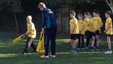 England Cricket's Sam Billings help children take part in cricket