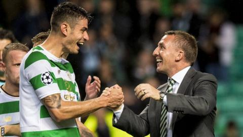Nir Bitton shakes hands with manager Brendan Rodgers