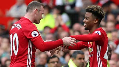 Wayne Rooney (left) and Santi Gomes