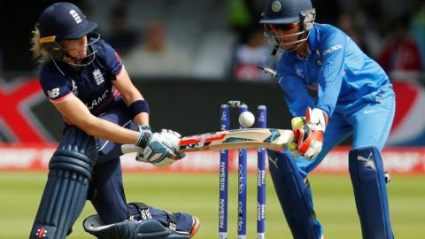 Lauren Winfield is bowled for England v India in the World Cup final