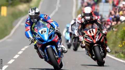 Michael Dunlop (left) in action in Superbike practice on the Isle of Man on Saturday