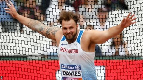 Aled Davies celebrates his gold medal