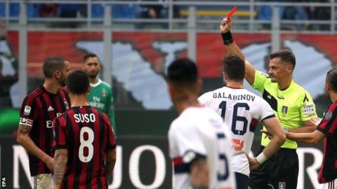 AC Milan held by Genoa after Bonucci sees red