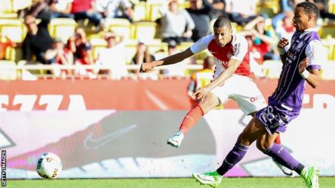 Monaco's French forward Kylian Mbappe scores against Toulouse