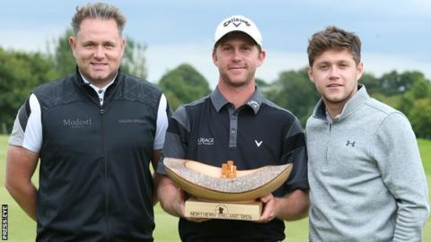 Robin Sciot-Siegrist (centre) received the NI Open trophy from Modest Golf directors Niall Horan (right) and Mark McDonnell