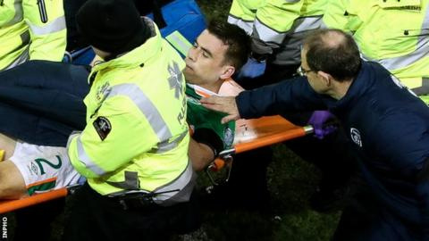 Martin O'Neill comforts Seamus Coleman as the full-back is stretchered off during the game against Wales