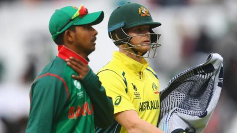 Australia captain Steve Smith walks off during a rain delay against Bangladesh