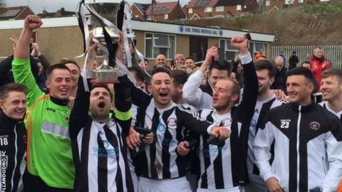 Llandudno players celebrate winning the Cymru Alliance title at Penycae