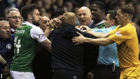 Hibernian manager Neil Lennon (centre) in amongst angry scenes