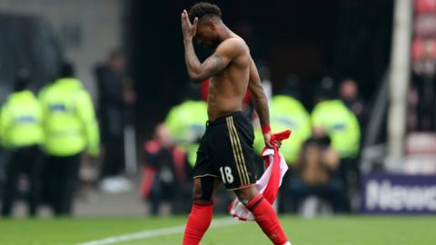Defoe walks off the pitch
