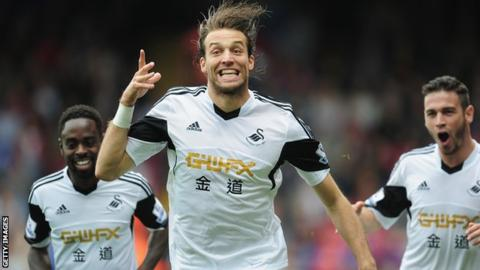 Former Swansea striker Michu retires from football