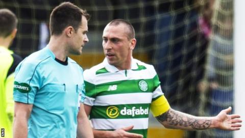 Referee Don Robertson and Celtic captain Scott Brown