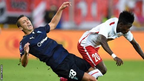 Nikola Djurdjic crashes to the turf under a challenge by Salzburg's David Atanga