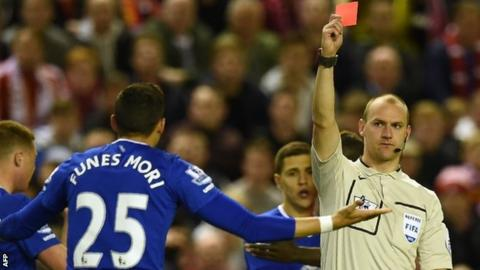 Ramiro Funes Mori is shown the red card by referee Robert Madley