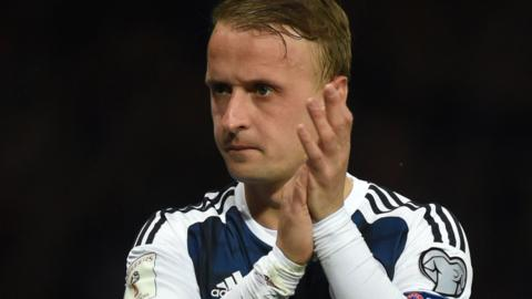 Leigh Griffiths applauds the Scotland fans after being forced off injured