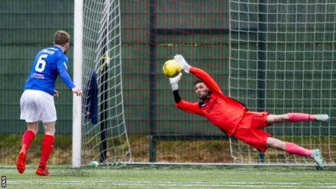East Kilbride's Matt McGinley saves from Kyle Miller