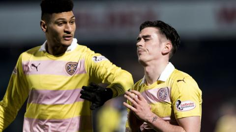 Jamie Walker is consoled by Bjorn Johnsen after missing a late penalty
