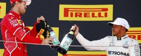 Vettel and Hamilton celebrate on the podium