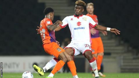 Aaron Tshibola announcement prompts SAVAGE reaction from MK Dons fans