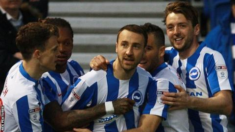 Glenn Murray celebrates his goal with teammates