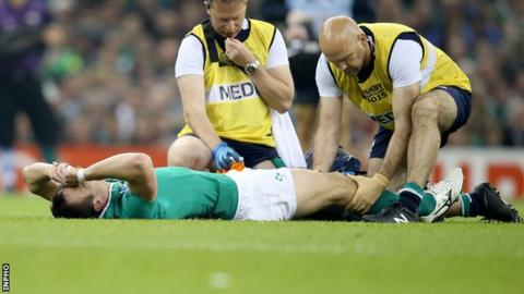 Tommy Bowe receives treatment after sustaining the knee injury