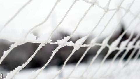 Snow on a football net
