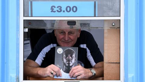 Manchester City programme seller