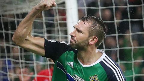 Gareth McAuley celebrates scoiring against Azerbaijan last year