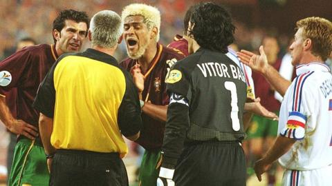 Portugal players surround the referee