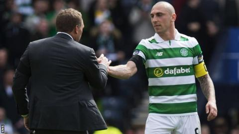 Celtic captain Scott Brown shakes hands with manager Brendan Rodgers