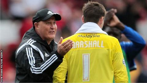 Russell Slade pats Cardiff City goalkeeper David Marshall on the back