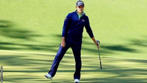 Russell Knox reacts to a missed putt in his second round