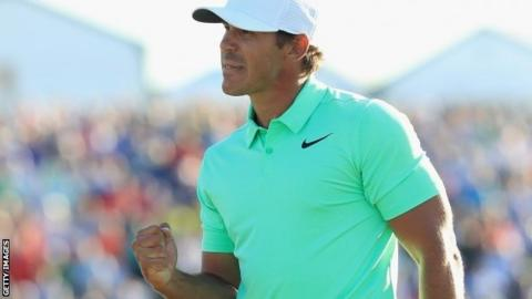 Brooks Koepka celebrates winning the US Open