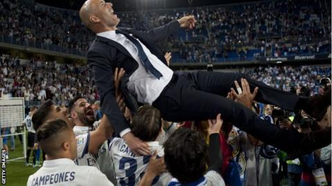 Zinedine Zidane is lifted into the air as Real Madrid celebrate winning La Liga on Sunday