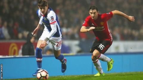 Connor Mahoney in action against Manchester United's Matteo Darmian