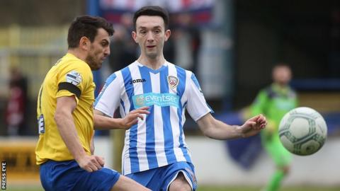 Mark Edgar (right) battles with Ballymena's Johnny McMurray last month