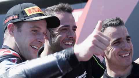 Jonathan Rea celebrates his win with Kawasaki mechanics