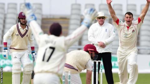 Ryan McLaren celebrates the dismissal of Somerset's James Hildreth at Old Trafford