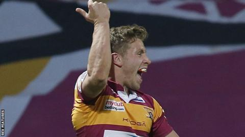 Huddersfield's Kyle Wood celebrates his try against Leeds