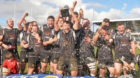 Bedwas players celebrate winning the Foster's Premiership Challenge Cup