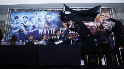 Dereck Chisora throws a table at Dillian Whyte