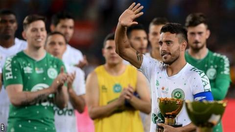 Chapecoense defender Alan Ruschel, who survived the plane crash which killed many of his team-mates, waves to the crowd at the Nou Camp