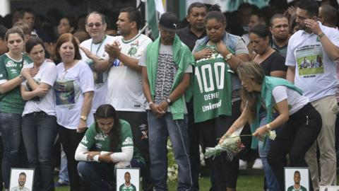 Supporters and families pay tribute to the deceased