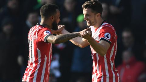 Ryan Bertrand and Jay Rodriguez (R) of Southampton celebrate