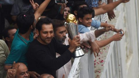 Sarfraz Ahmed holds aloft the Champions Trophy