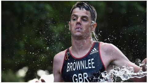 He ain't heavy! Alistair Brownlee carries brother over finish line