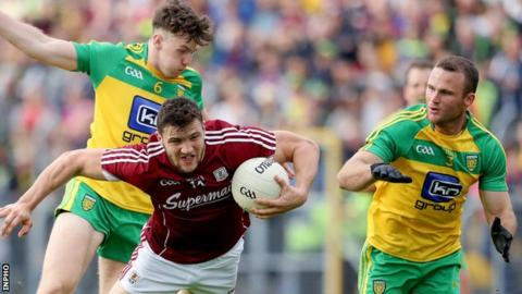 Donegal's Kevin Gillespie collides with Galway opponent Damien Comer in the Sligo qualifier